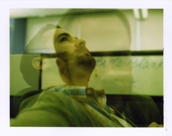 Photo of a man looking up and daydreaming by benprks via Flickr