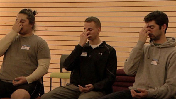 Photo of veterans practicing mindfulness via Free the Mind Documentary