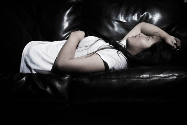 Photo of girl laying on a couch by Sodanie Chea via Flickr