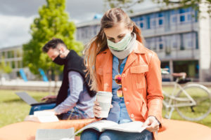 College Students Wearing Masks And Staying Distant During Covid