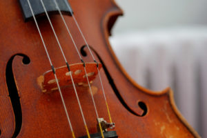 Close up of a violin to show that learning well-being is like learning how to play a violin
