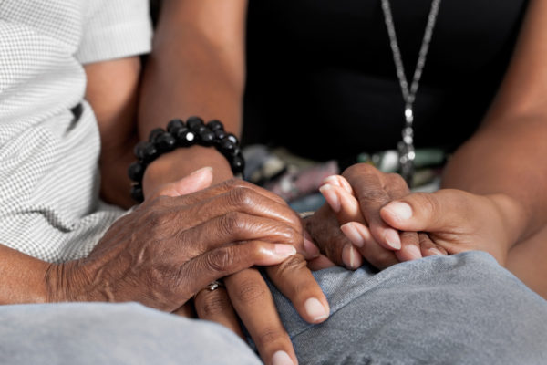 Two people holding hands by MichaelJay via iStockPhoto