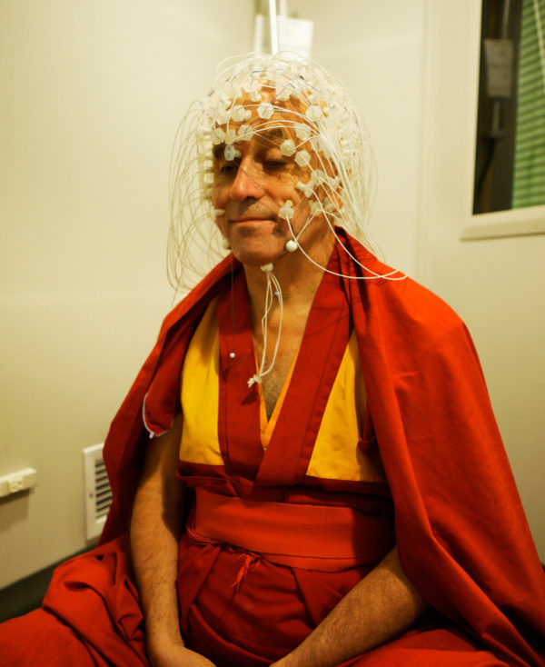 Monk Matthieu Ricard meditates with EEG on scalp by Jeff Miller