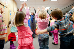 Young kids participate in mindful movement as part of Kindness Curriculum