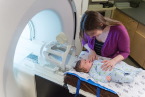 Infant and mother in imaging room for Baby Brain and Behavior Project