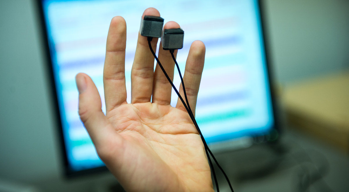 Photo of hand sensor collecting pulse from Center for Healthy Minds
