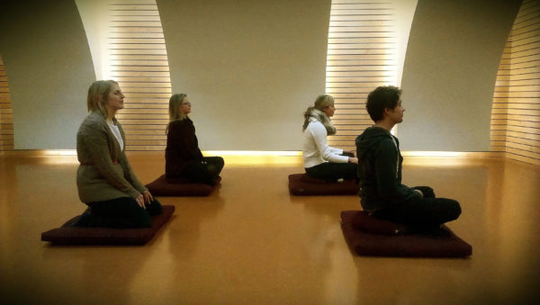 Photo of group meditating