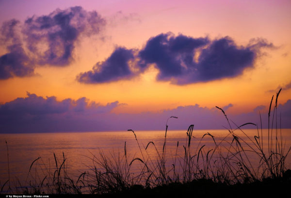 Picture of a sunset above water by Moyan Brenn via Flickr