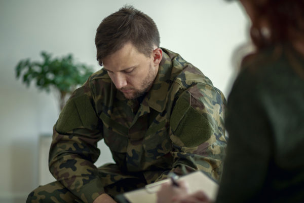 Veteran Talking To Therapist Seeking Mental Health Treatment