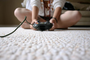 Photo of child playing a video game by Chapendra from Flickr