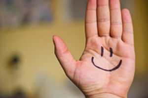 Hand with happy face drawn on by Ben Smith via Flickr